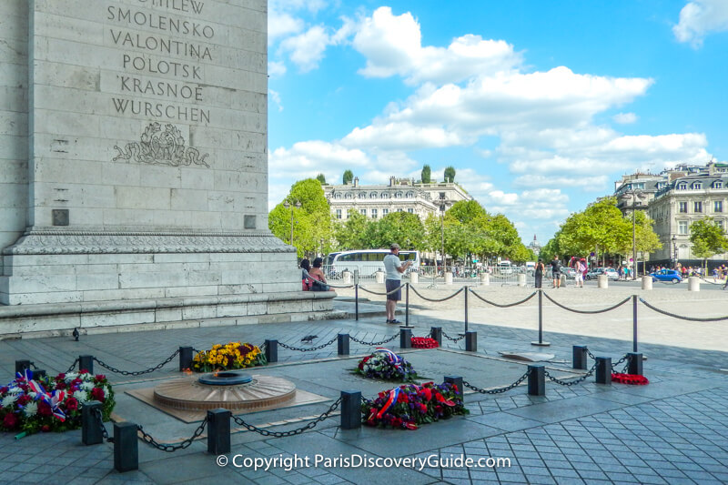 Eternal flame at the Tomb of the Unknown Soldier under the Arc de Triomphe in Paris