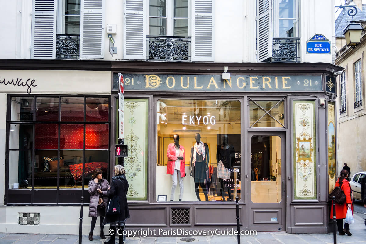 Trendy fashion boutique in a former bakery and sumptuous linens in the shop next door in the Marais