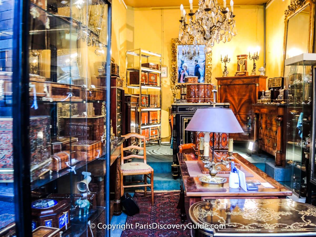 Inlaid boxes and fine furniturein antiques showroom at Paris Flea Market