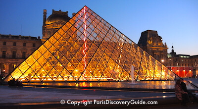 Louvre pyramid at night in Paris