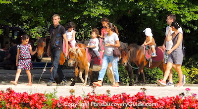 Pony rides for children at Square Georges Brassens in Paris