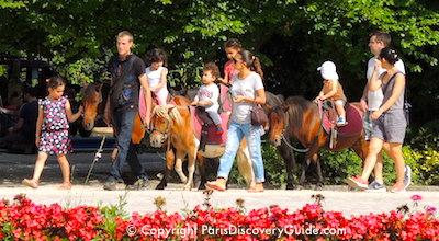 Pony rides for children at Square Georges Brassens in Paris