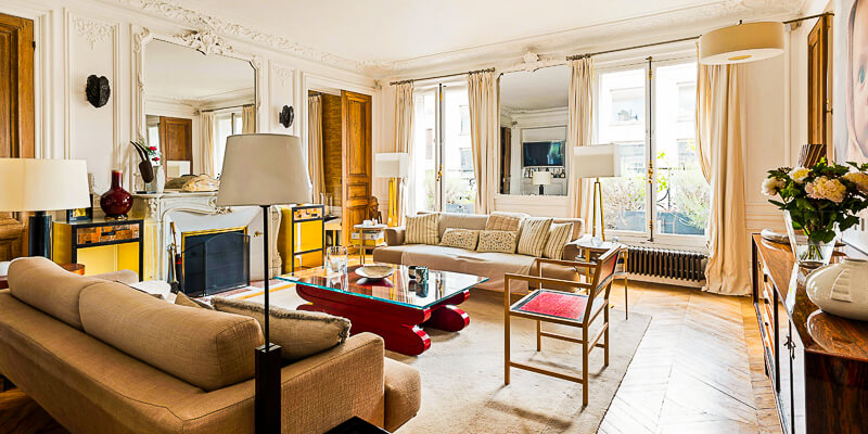 Spacious living room in the Ash & Timber apartment near Arc de Triomphe