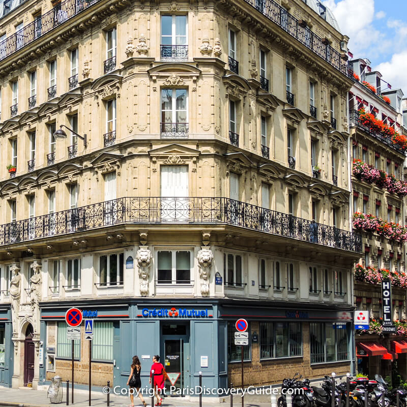 ATM machine (inset in stone wall near door in lower left corner) at Crédit Mutuel on Rue Monge in Paris's 5th arrondissement