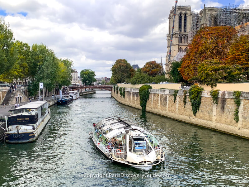 Seine River cruise boat as it passes Notre Dame