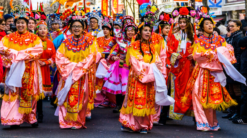 Ribbon dance troop marching in the Chinese New Year Parade in the 13th arrondissement in Paris