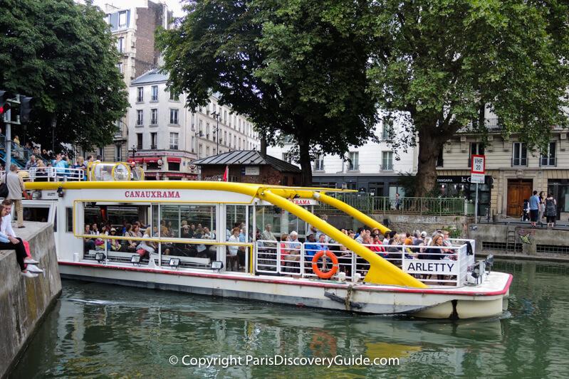 Cruise boat in Canal Saint-Martin as it heads toward Bassin de laVillette