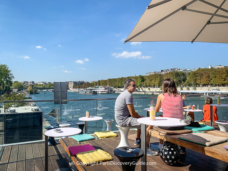 Rooftop terrace at Fluctuart, floating art venue on the Seine River