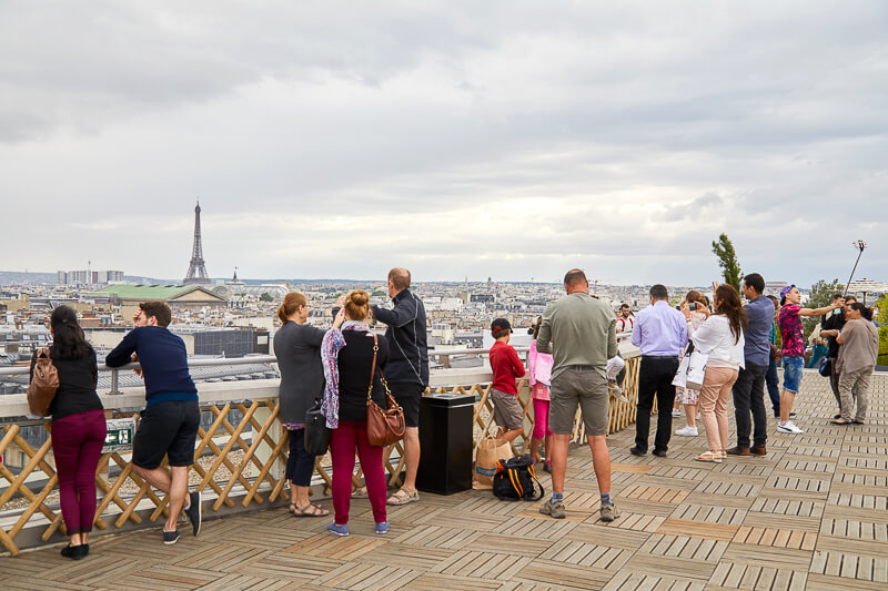 View of EiffelTower and Paris skyline from GalerieLafayette's rooftop terrace - Photo credit: iStock.com/AndreaAstes