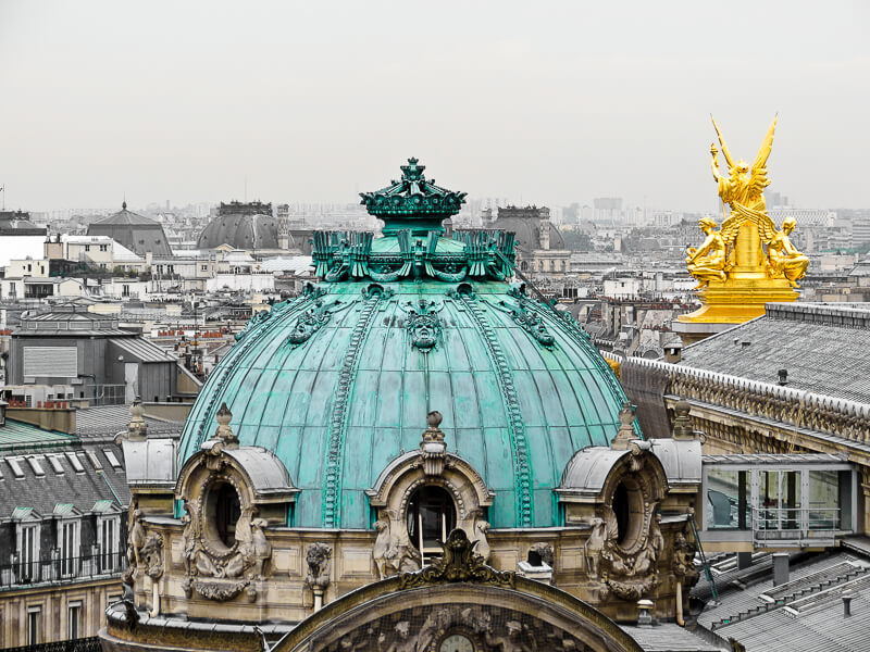 Skyline view of Palais Garnier (Paris Opera House) & other Paris rooftops from terrace at Galeries Lafayette - Photo credit: iStock.com/arndale