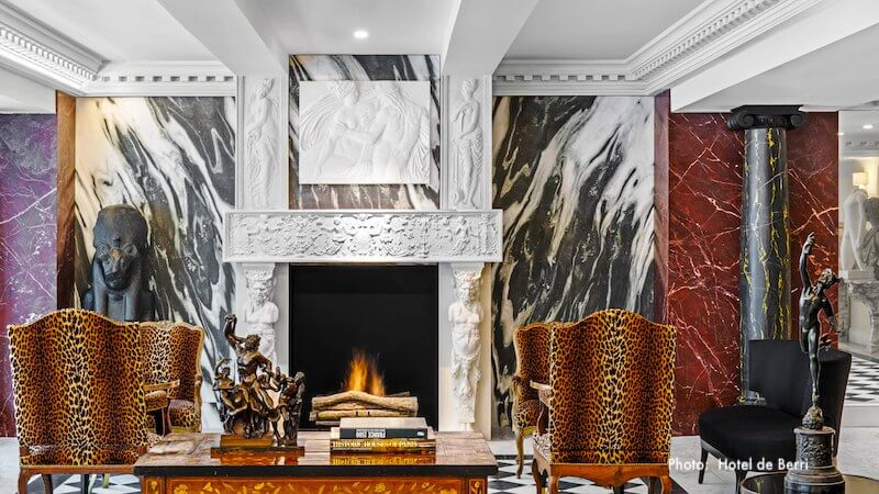 Fireplace in a corner of Hôtel de Berri's expansive and luxurious lobby
