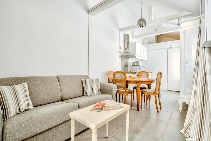 Living room, dining area, and kitchen at Le Petit Pavillon de Versailles