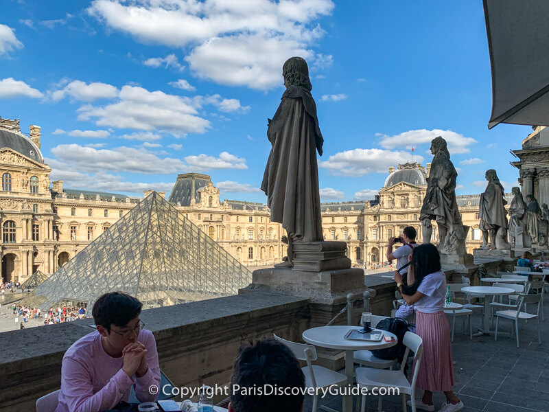 Cafe Molien's terrace seating overlooking the Pyramid at the Louvre Museum