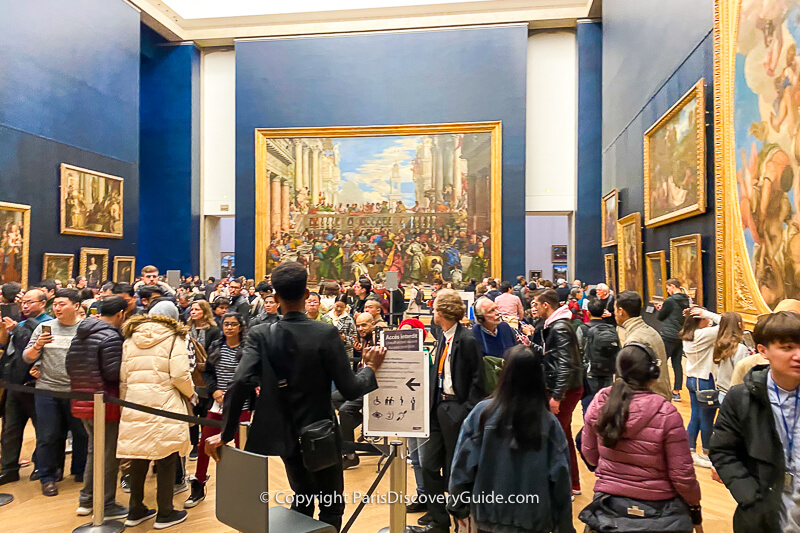 The front part of the line to see Mona Lisa - the rest of the line continues beyond the back wall