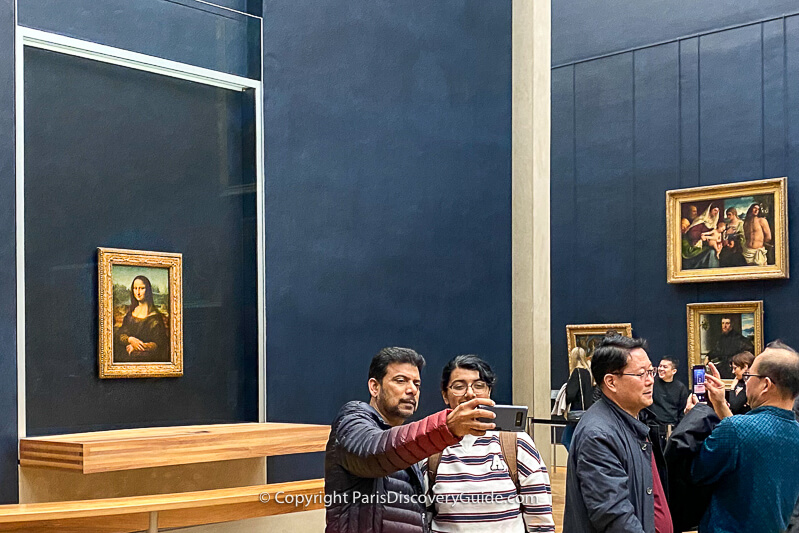 Mona Lisa on display in a bullet-proof glass case in the Louvre