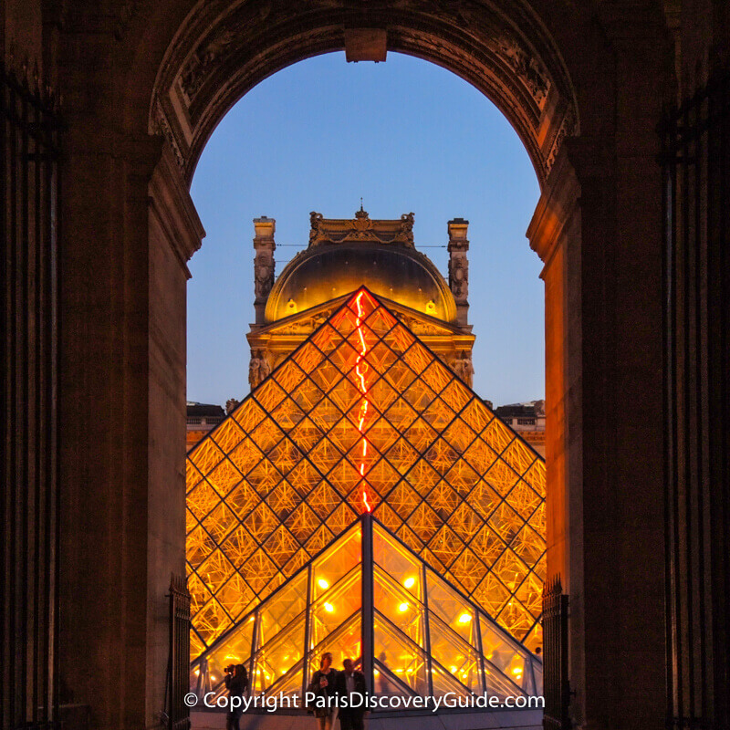 The Louvre and Pyramid at night from the Richelieu Passage