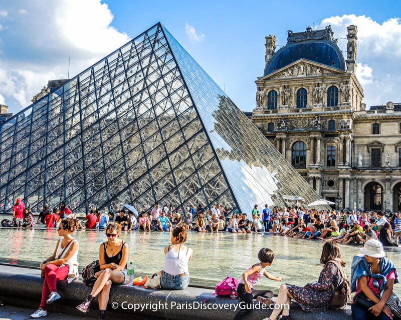 Reflecting pool next to the Musée eu Louvre's glass pyramid on a beautiful July afternoon