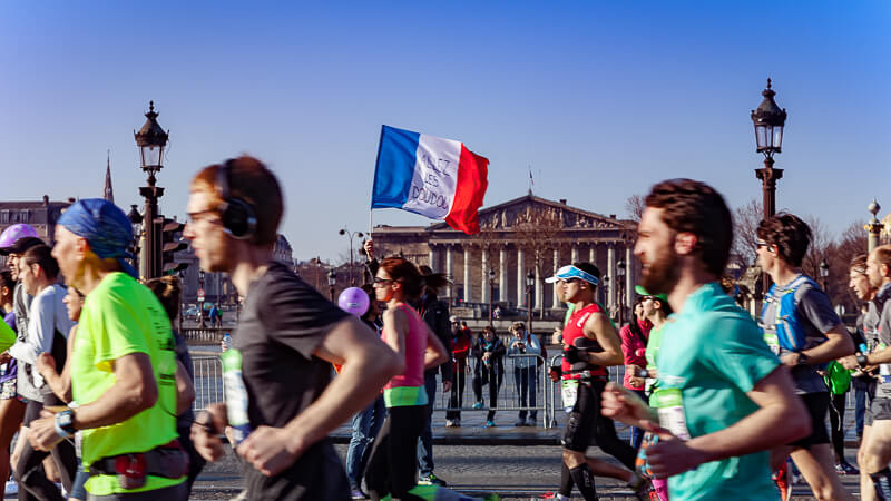 Paris Marathon runners with Assemblée Nationale in the background - Photo credit: istockphoto.com/onickzartworks
