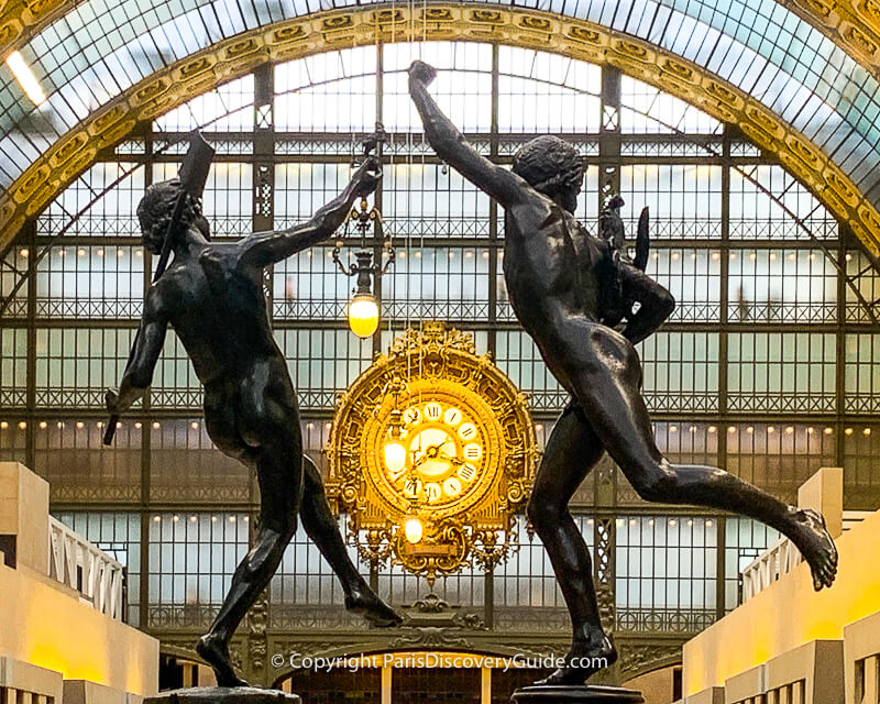 Statues and golden clock at the Orsay Museum