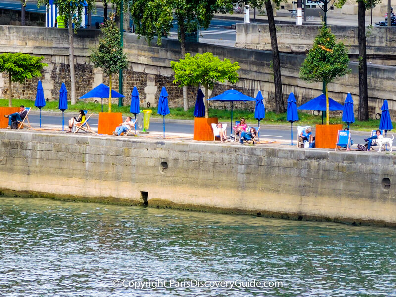 Beach chairs and umbrellas on the Right Bank of the Seine
