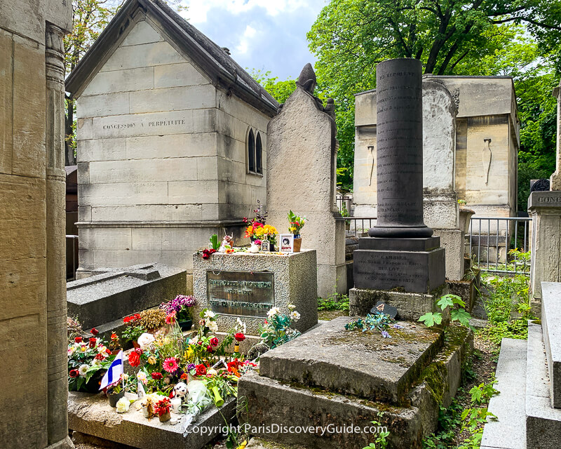 Flowers, candles, and momentos on Jim Morrison's grave in Pere Lachaise Cemetery