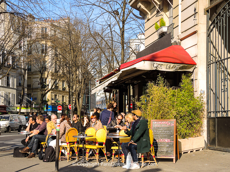 Outdoor seating at Cafe La Factorie Saint Amour next to Pere Lachaise Cemetery in early March