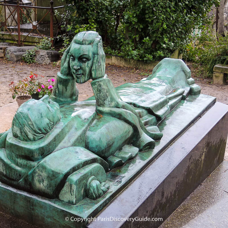 Grave of Fernand Arbelot, gazing at a mask representing his wife