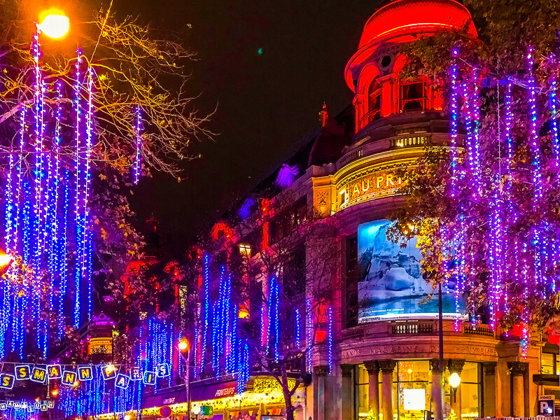 Holiday lights and decorations at Printemps and Boulevard Haussmann