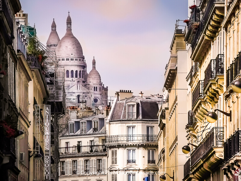 View of Sacre Coeur from Rue Rossini in Paris's 9th District