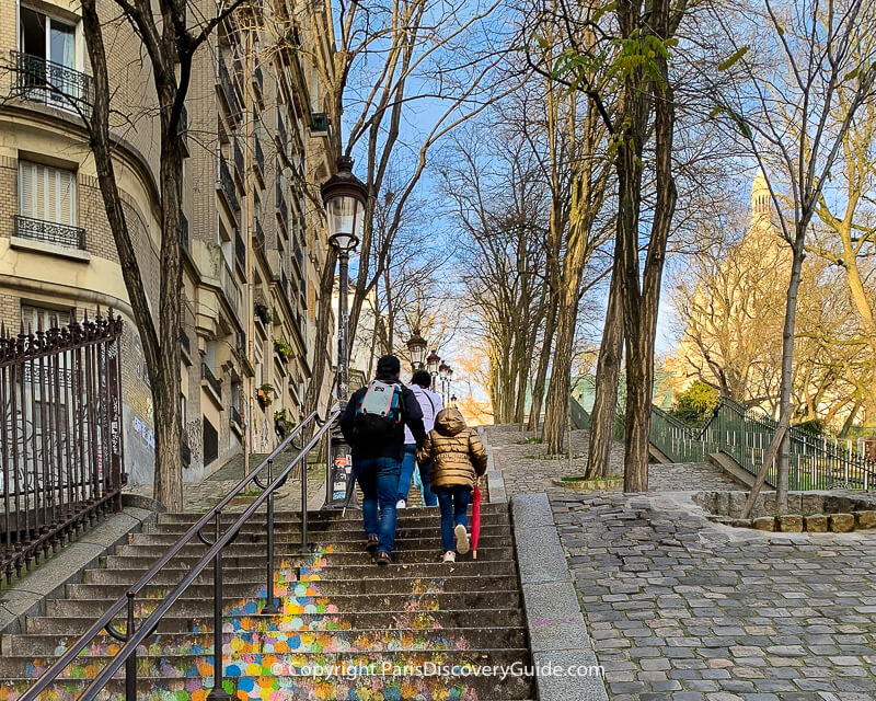 Climbing the steps up to Sacre Coeur in Montmartre