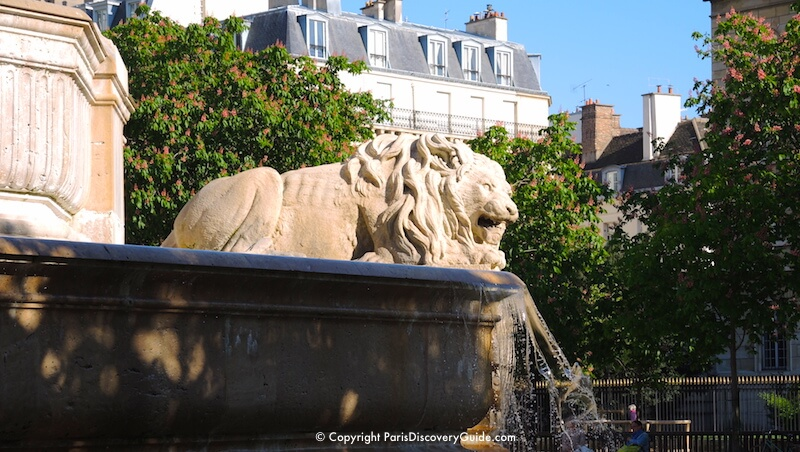 Lion sculpture on fountain dating back to mid-1800s in front of Church of Saint-Sulplice in the 6th Arrondissement in Paris