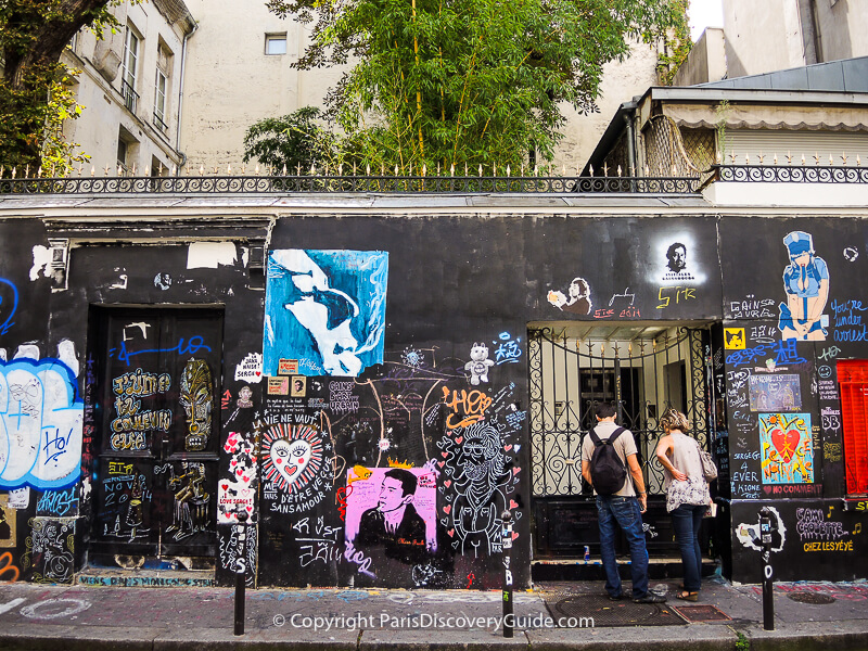 Graffiti across the front of Serge Gainsbourg's home in the 6th arrondissement