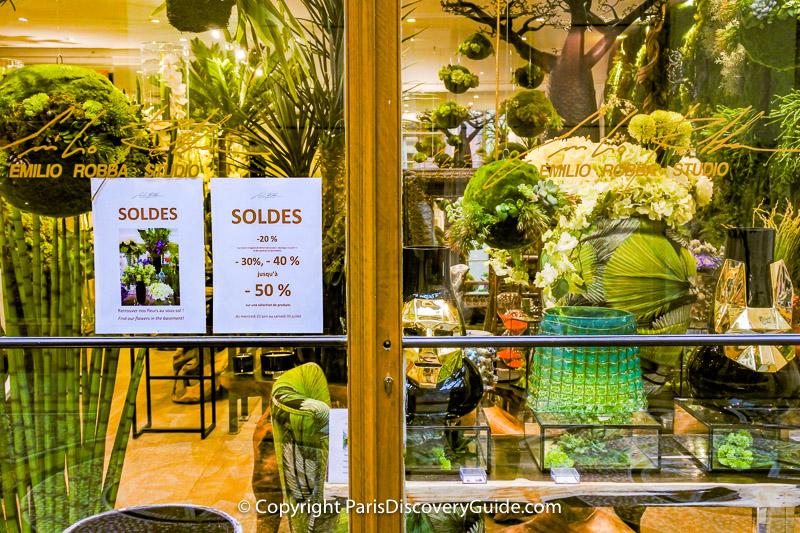 Soldes signs at Emilio Robba, designer of exquisite silk flowers in Galerie Vivienne in the 2nd arrondissement in Paris