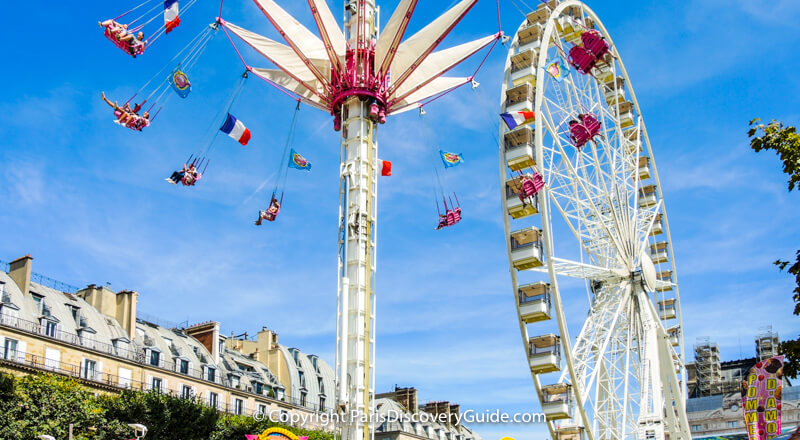 Giant ferris wheel and thrill ride at Tuileries Garden Carnival