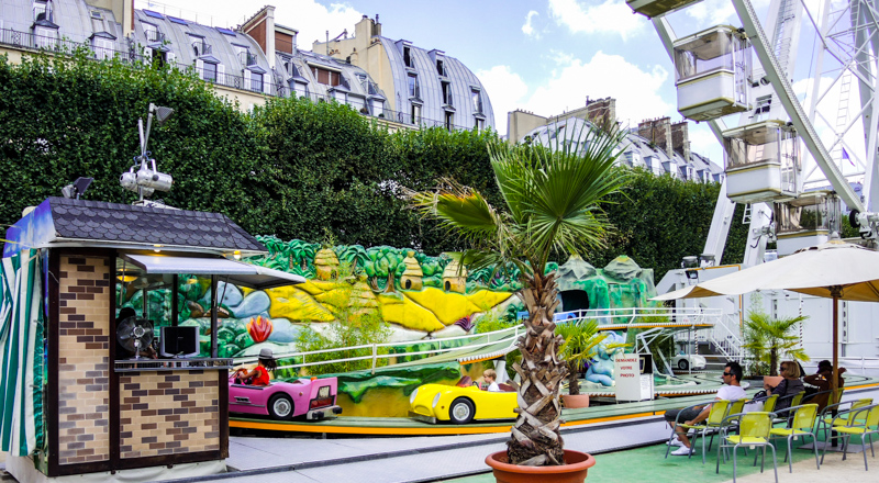 Bumper cars and ferris wheel at Tuileries Garden Carnival