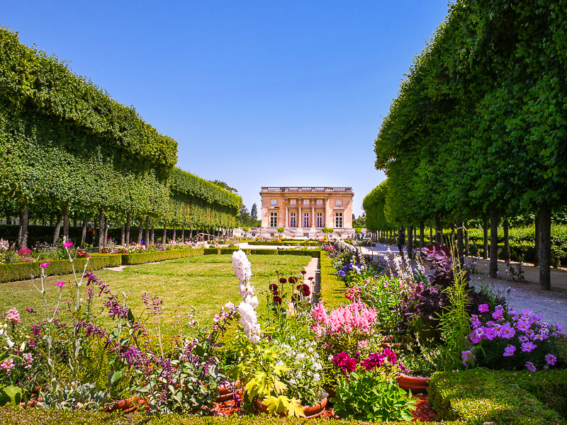 Flower gardens in front of Marie Antoinette's Petit Trianon - Photo credit: Herbert Frank