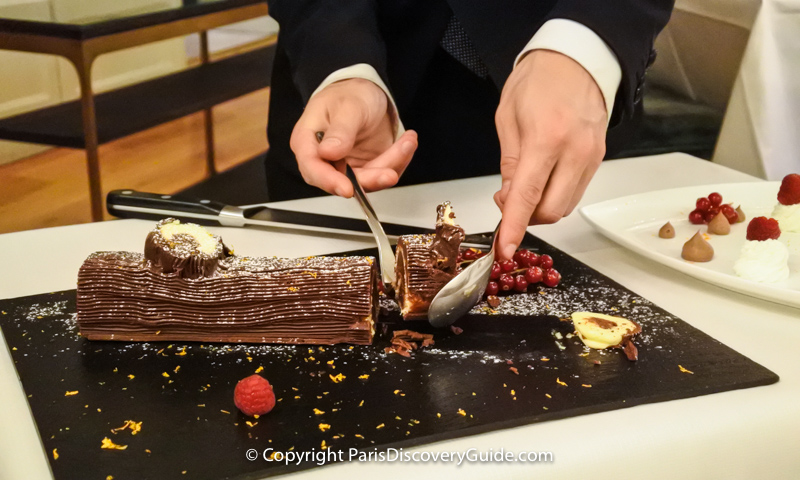 "A slice of Bûche de Noël being served as dessert at ""La Cuisine de l'E7"" restaurant at Hotel Edouard VII near the Paris Opera House"