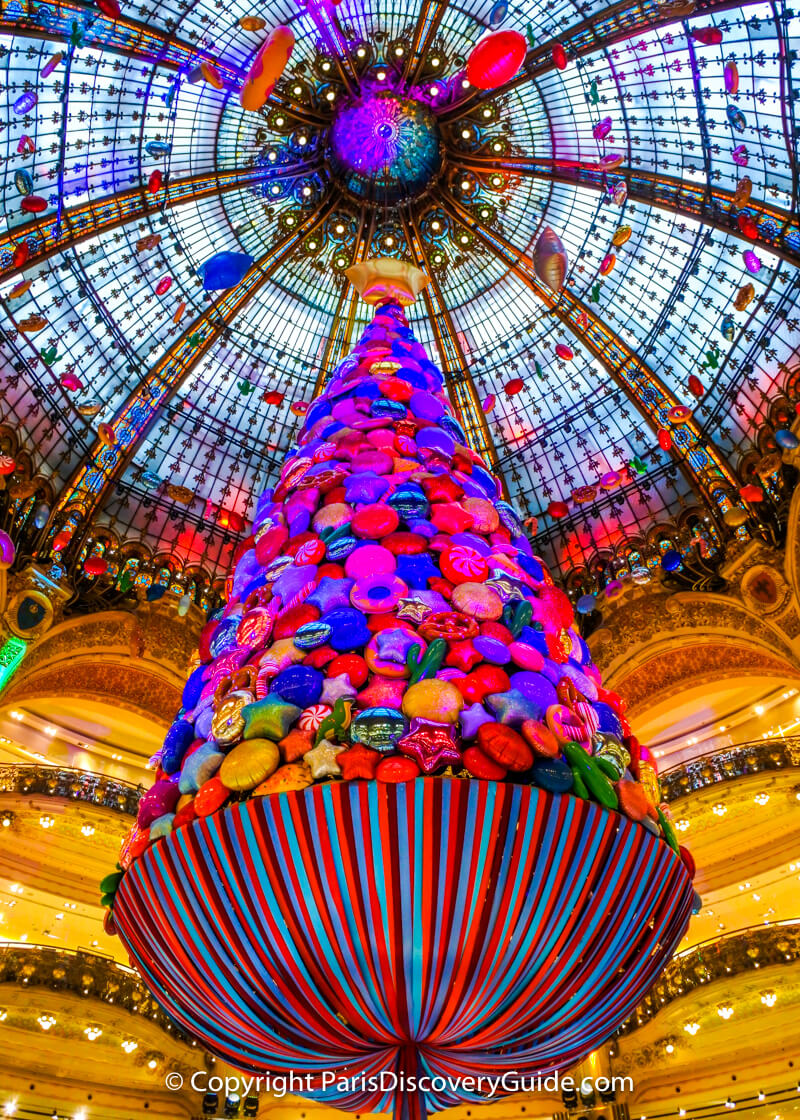 A giant candy tree floats from Galeries Lafayette's domed ceiling