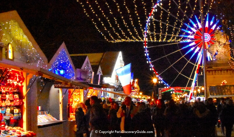 Paris Christmas Markets along Champs Elysees with ferris wheel at Place de la Concorde