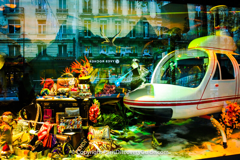 In this window, the children have landed in an airplane at the bottom of the sea amid coral reefs and a treasure chest filled with Fendi designer handbags