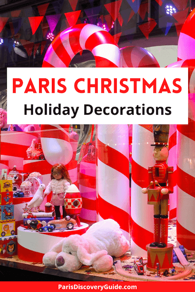 Holiday window display at Galeries Lafayette with candy canes and toys