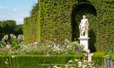 Formal garden room and statue at Versailles Gardens