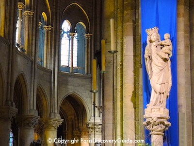 Madonna and child statue in the Notre Dame Cathedral in Paris