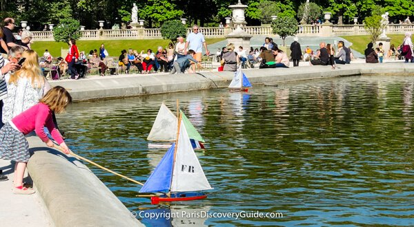 Toy sail boats on pond in Luxembourg Garden, Paris