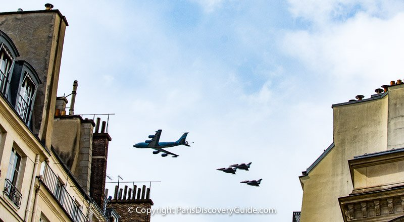 Bastille Day military flyover seen from rue Molière near Palais Royal