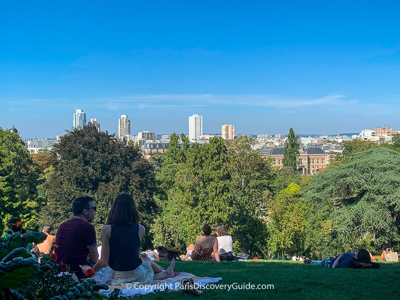 Can you spot the Eiffel Tower along the Paris skyline in this photo from Parc Buttes-Chaumont?