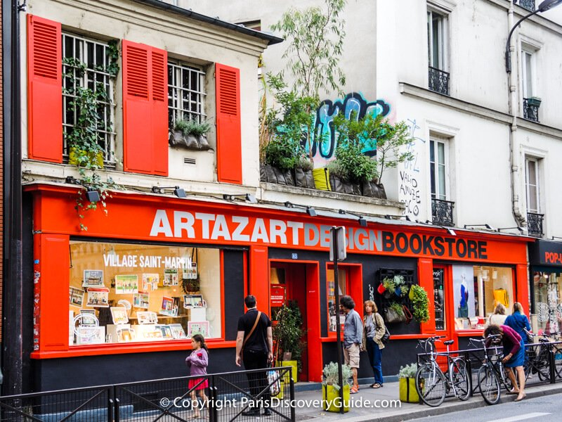 """Artazart """"concept"""" bookstore where art and design books, an eclectic assortment of other items, and exhibitions and events share space in an eye-catching storefront overlooking Canal Saint Martin"""