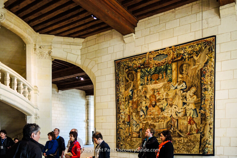 Tapestry, staircase, and beams inside Chambord Castle