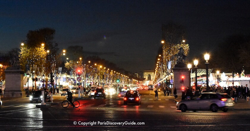 Paris Christmas Markets along Champs Elysees with holiday lights