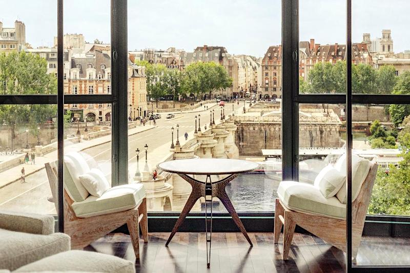 Private balcony at Le Cheval Blanc overlooking the Pont Neuf bridge and the Seine River